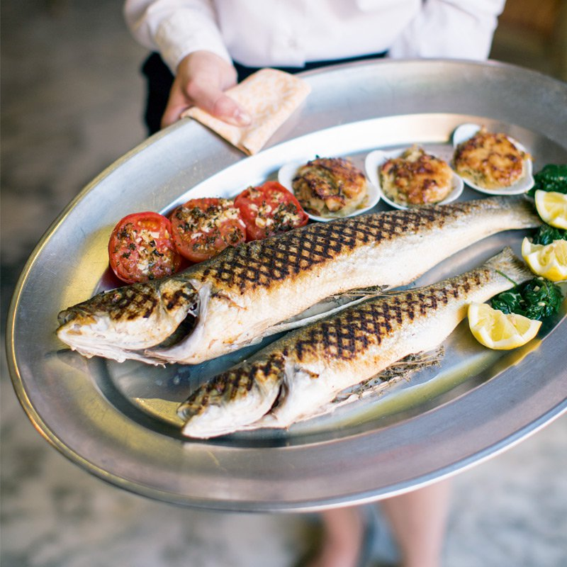 Fresh fish with stuffed tomatoes from the à la carte menu at La Ponche. Photograph: Helen Cathcart