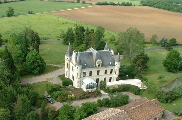 This beautiful château in Gironde was built in 1834 and includes eight hectares of grounds with a pool, tennis court, and gardens.