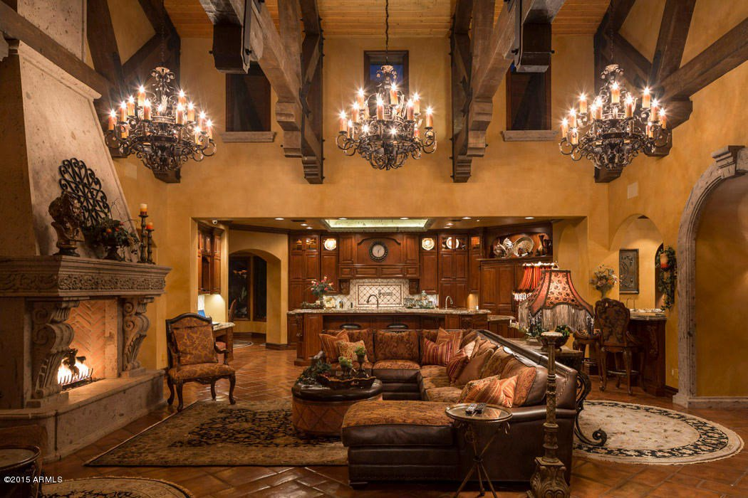 This gorgeous European-style villa, perched on Camelback Mountain hillside in Paradise Valley, Arizona, features walnut flooring and unique multi-tiered chandeliers.