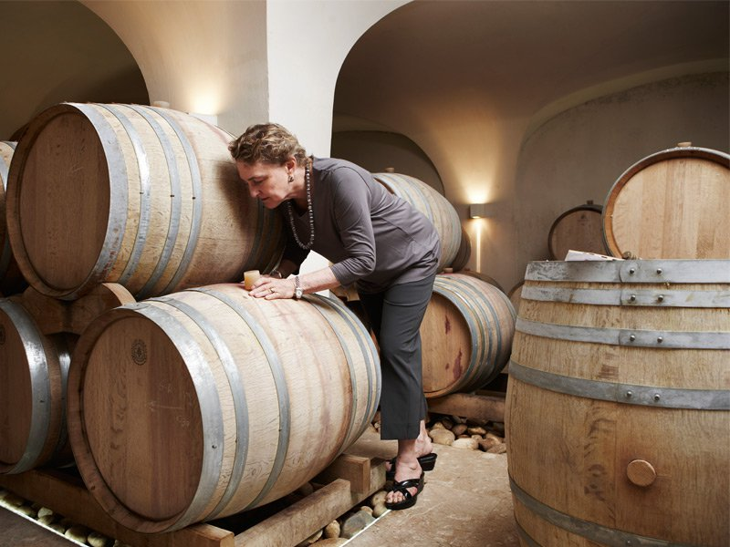 Wine consultant Zelma Long checks barrels in the vineyard's cellar. Photograph: Jude Edginton