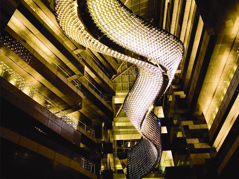 Linking two buildings, Reflective Flow by designer Beau McClellan comprises 2,300 hand-ground optical crystals and 55,000 LEDs, making it the largest chandelier in the world