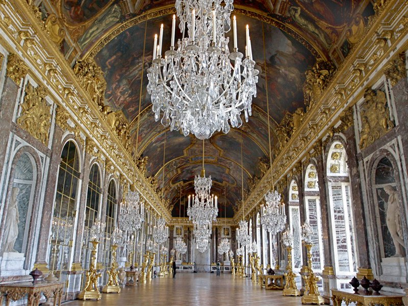 The chandeliers in the Hall of Mirrors in the Palace of Versailles hold some 1,000 candles. Photograph: PA