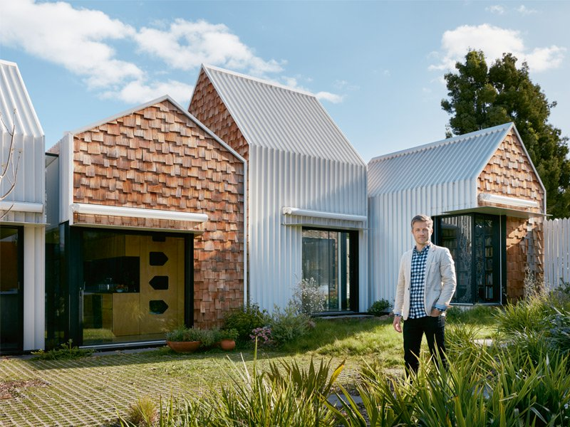 """Banner image: Boštjan Gabrijelčič's Atrium House is under construction in Marles, Slovenia. Photograph courtesy Arhitektura Doo. Andrew Maynard in the garden of his Tower House in Alphington, Melbourne. The owners asked for """"a home for community, art, and nature to come together."""" The practice designed them """"a village"""" of separate, yet connected, buildings. Photograph: Lucas Allen"""