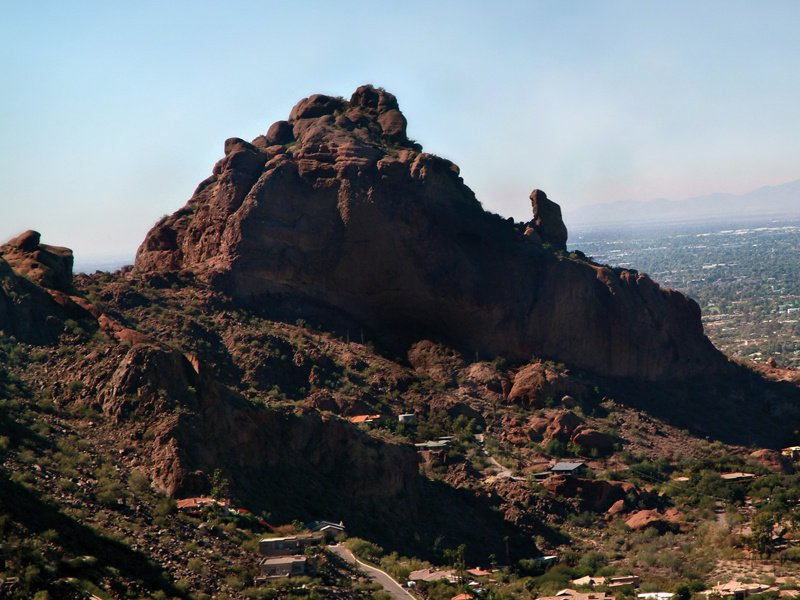 The Praying Monk rock formation, so named as it resembles the silhouette of a man kneeling in prayer, rises approximately 100 feet, has several trails to climb, and offers spectacular views from the summit. Photograph courtesy of Scottsdale Convention & Visitors Bureau.