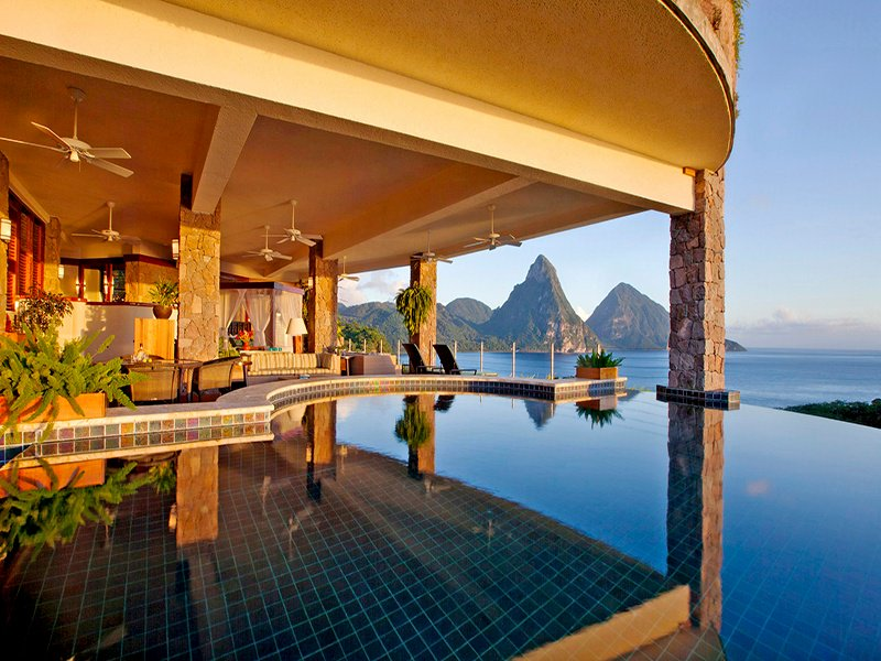 Big sweeping spaces and infinity pools with panoramic views of the Caribbean Sea and Piton Mountains characterize the sumptuous sanctuaries of the Jade Mountain resort.