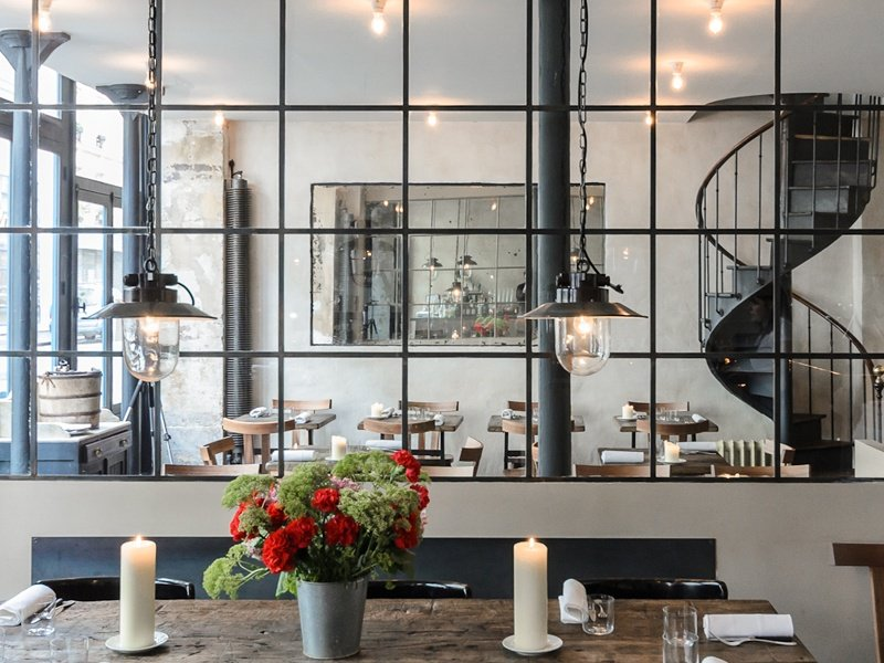 With distressed wooden tables and metal accents, the interior of Septime is more Scandinavian modern than typical French bistro.