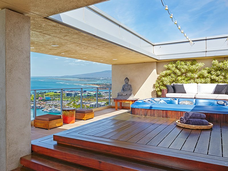 This premier two-story penthouse in Honolulu has a roof-top Jacuzzi deck that has both outdoor and covered seating so it can be enjoyed all year round.