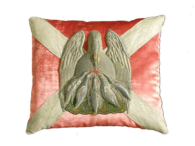 A hand-sewn antique metallic ecclesiastic pelican appliqué pillow by Rebecca Vizard.