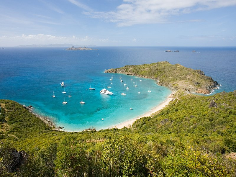 The calm waters of Colombier beach, or Rockefeller's beach, make it ideal for snorkeling. Photograph: Pierre Carreau.