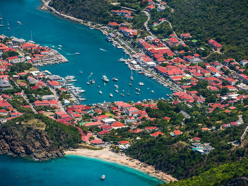 Gustavia Harbor is considered to be one of the most exclusive marinas in the Caribbean. Photograph: Sebastien Martinon. Banner image: Laurent Benoit.