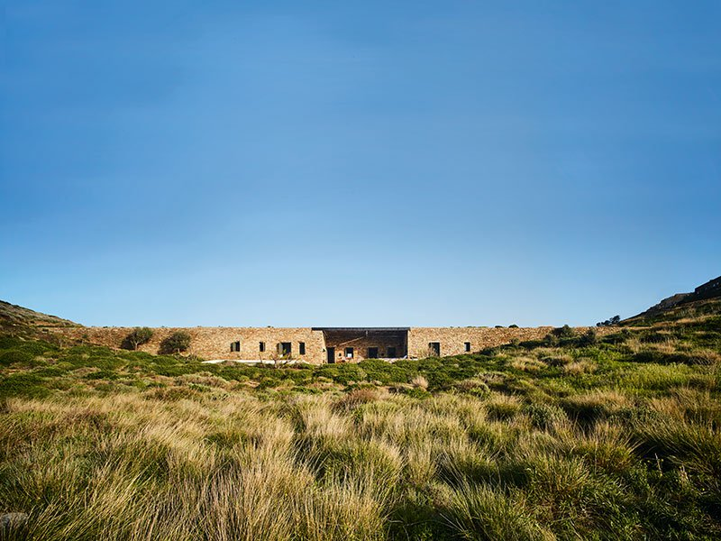 Built by decaArchitecture, Aloni successfully blurs the lines between building and landscape, allowing the house to blend in with the rugged terrain of the Greek island of Antiparos. Photograph: Michael Branthwaite. Banner: Larch-detailed guesthouses feature in this unobtrusive hotel in rural Norway by Jensen & Skodvin.