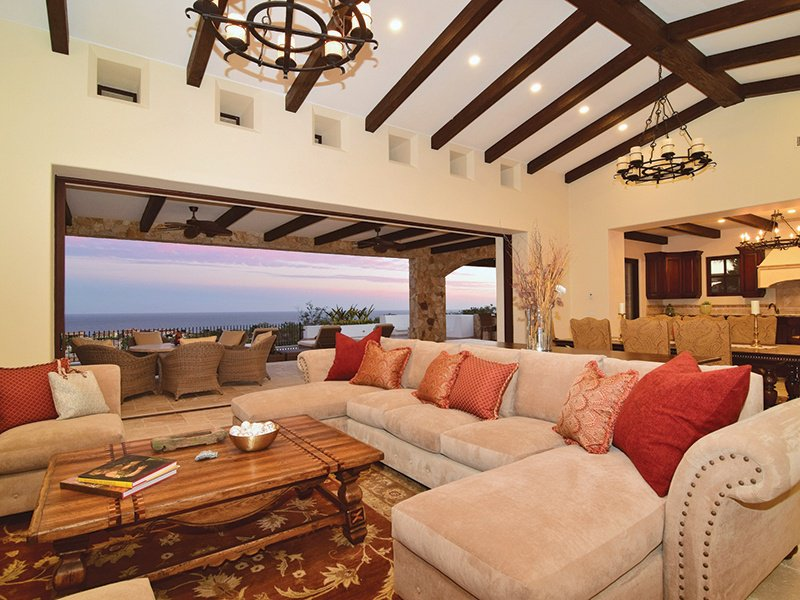 Casa Kay boasts an open living and dining space off the well-appointed kitchen, complete with a covered outdoor terrace and infinity-edge pool.