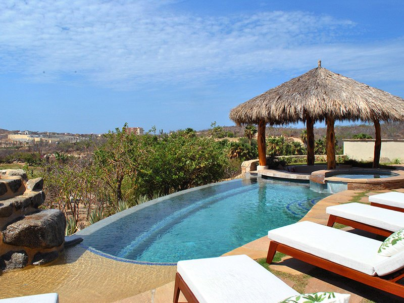 The four-bedroom Casa Sirena has a charming pool and barbecue area, an open kitchen with granite-topped island counter, and high ceilings with wood beams.