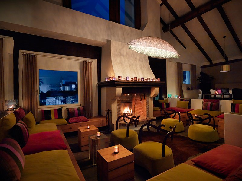 St Moritz's five-star Hotel Giardino Mountain has a stunning bar area, featuring a crackling fireplace, cozy nooks, and beamed ceilings along with an outdoor terrace. Photograph: Giardino Group