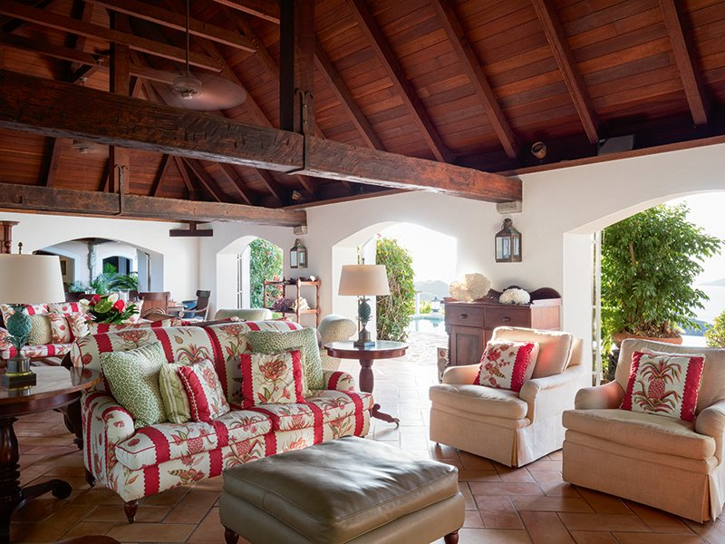 The villa's spacious, open-plan living and dining area leads out to the terrace.