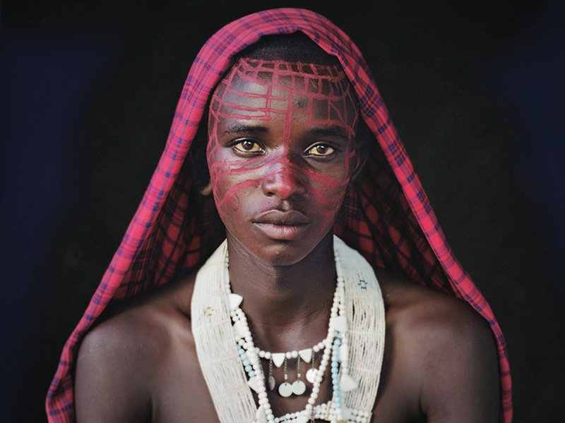 """A Maasai boy of Ngorongoro, in the Serengeti, Tanzania. Through his Before They Pass Away project, Jimmy Nelson has sought to document indigenous people """"in a very iconic and beautiful way."""" Photograph: © Jimmy Nelson Pictures BV"""
