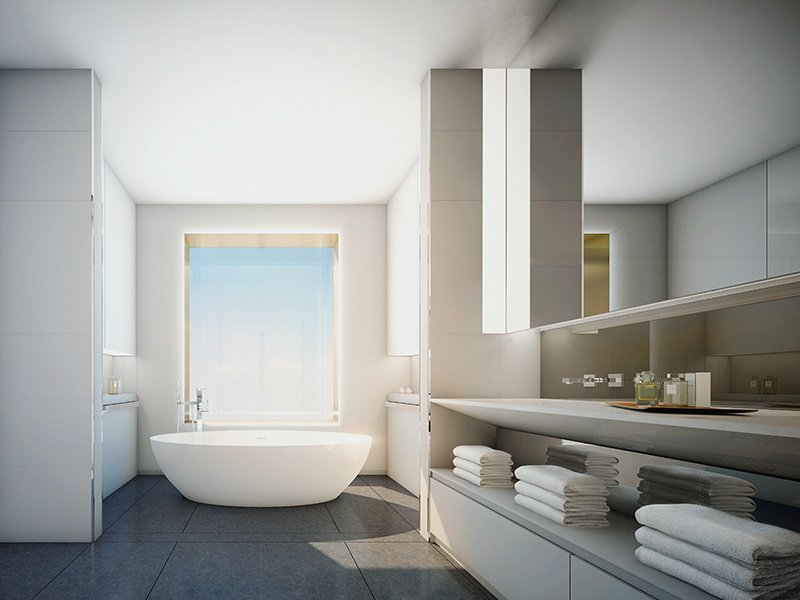 At 551 West 21st Street, freestanding tubs and picture windows are complemented by Quarella stone walls and custom Corian® surrounds. Banner image: A bathroom designed by Burdge & Associates Architects.