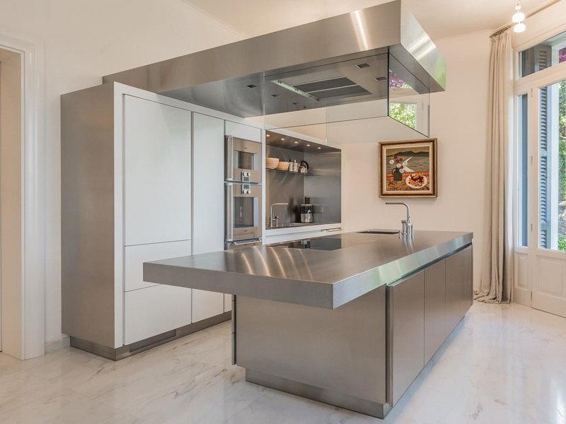 This four bedroom villa in Liguria Portofino, Genoa has a strikingly modern kitchen with windows that frame the spectacular Portofino scenery. On the market with Immobilsarda, the exclusive affiliate of Christie's International Real Estate in the region, it would make a stunning location for a celebratory dinner party with a private chef at the helm.