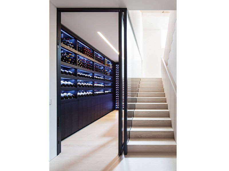 Feature lighting adds to the visual drama in a storage room from Wine by Design.