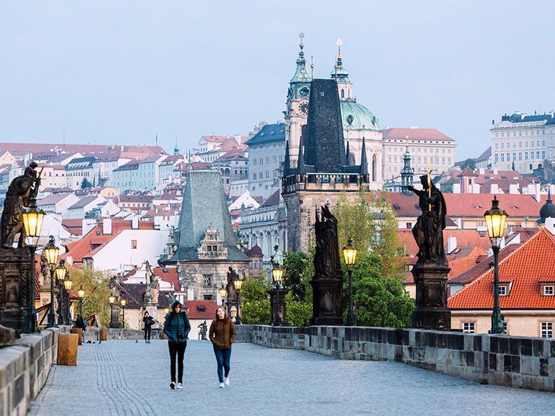 In addition to the iconic Charles Bridge, Prague offers diverse neighborhoods to explore, from the winding streets of Malá Strana to the leafy Vinohrady and its café culture. Photograph and banner image: Getty Images