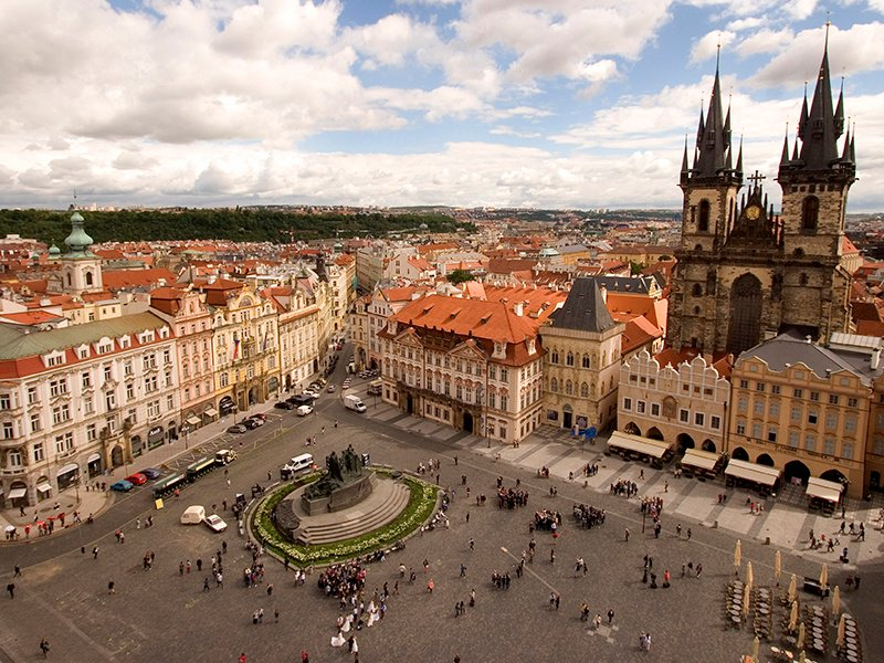 Originally the city's central marketplace, the Old Town Square dates from the 12th century and is still surrounded by remarkable Romanesque, Baroque, and Gothic buildings. Photograph: Getty Images