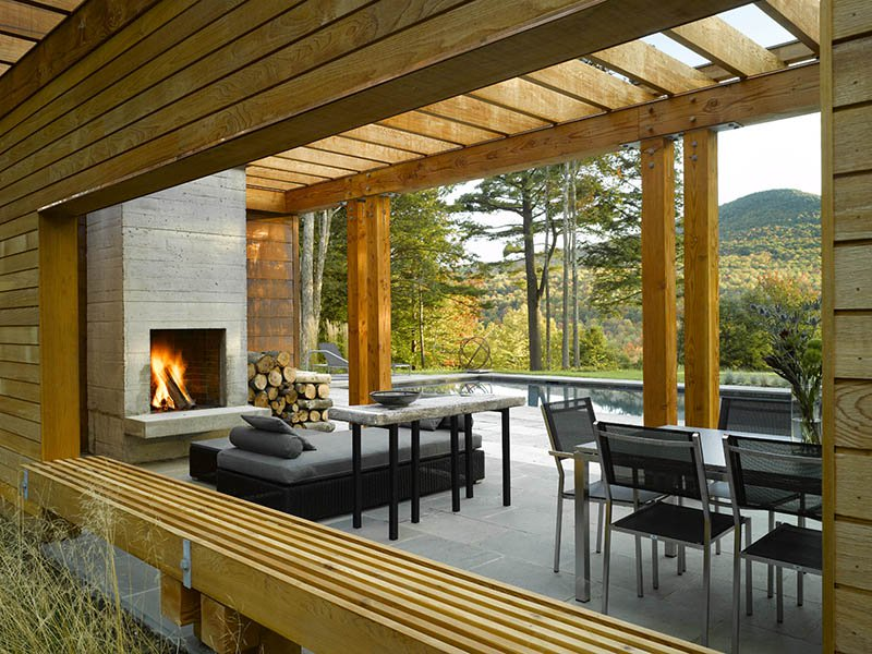 Wagner Hodgson designed this open-concept house in Stowe, Vermont, which provides far-reaching views while also offering a warm, inviting setting thanks to an outdoor fireplace.