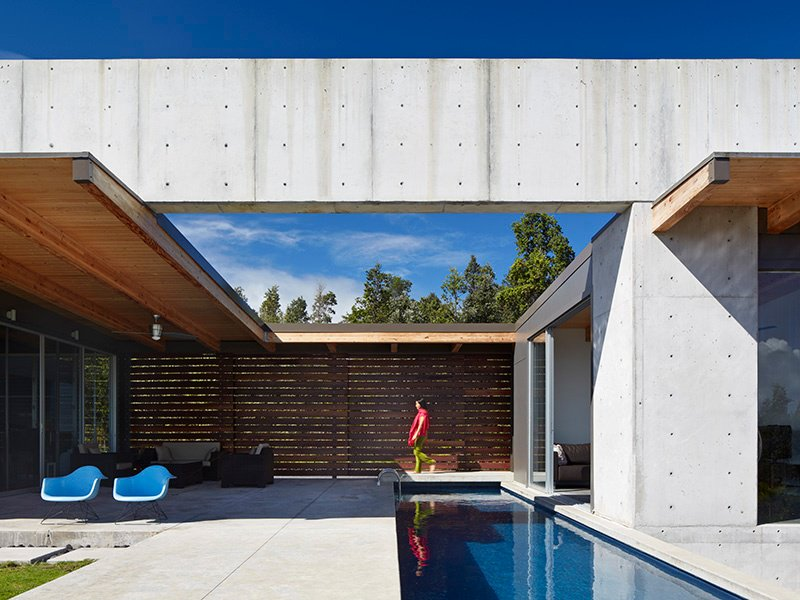 The main feature of Craig Steely's Lavaflow 7 home in Hawaii is a 140-foot-long concrete beam running the length of the building, with only three short concrete walls supporting it along its massive span. Photograph: Bruce Damonte. Banner image: The interior of Concrete House in Melbourne, Australia, by Matt Gibson Architecture. Photograph: Derek Swalwell
