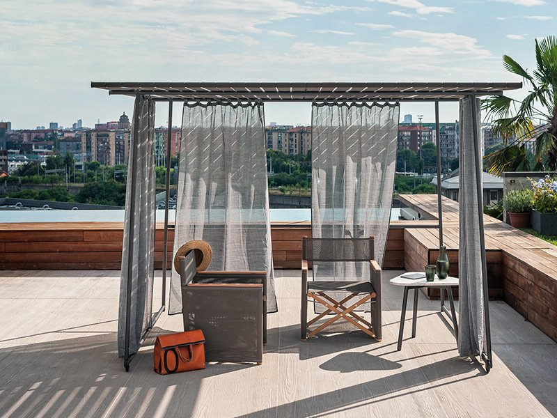 A moveable, self-supporting sunshade, Roda's Ombrina gazebo filters the sun, with loose curtains allowing in the breeze.
