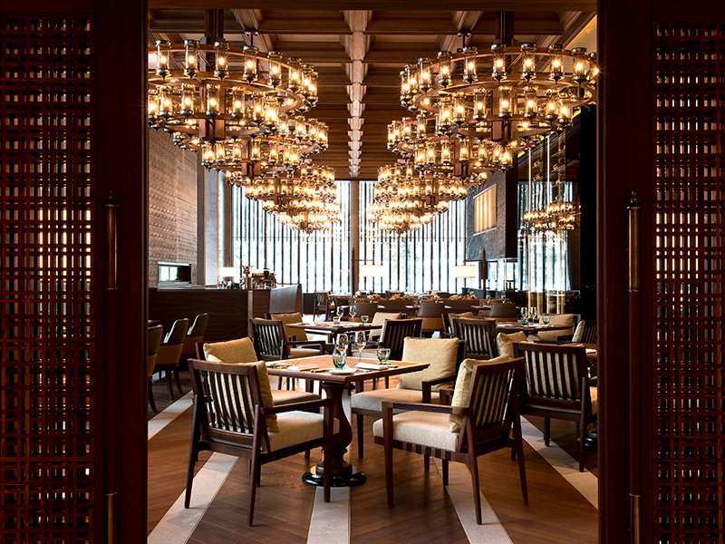 Observe skilled chefs preparing your meal at The Restaurant at The Chedi Andermatt, which showcases the best in Asian and European cuisines.