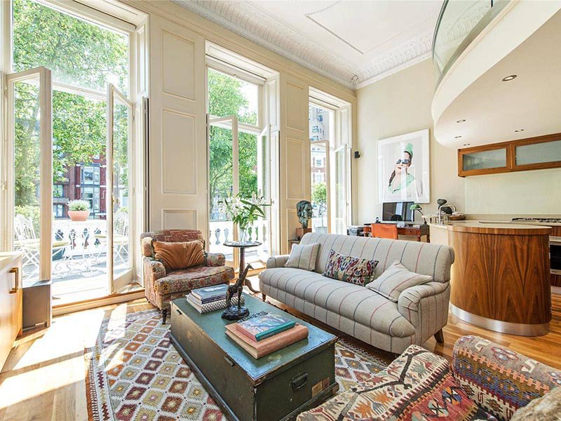 A light-filled two-bedroom, two-bathroom flat in a period property, this South Kensington property also has a private balcony overlooking a garden.