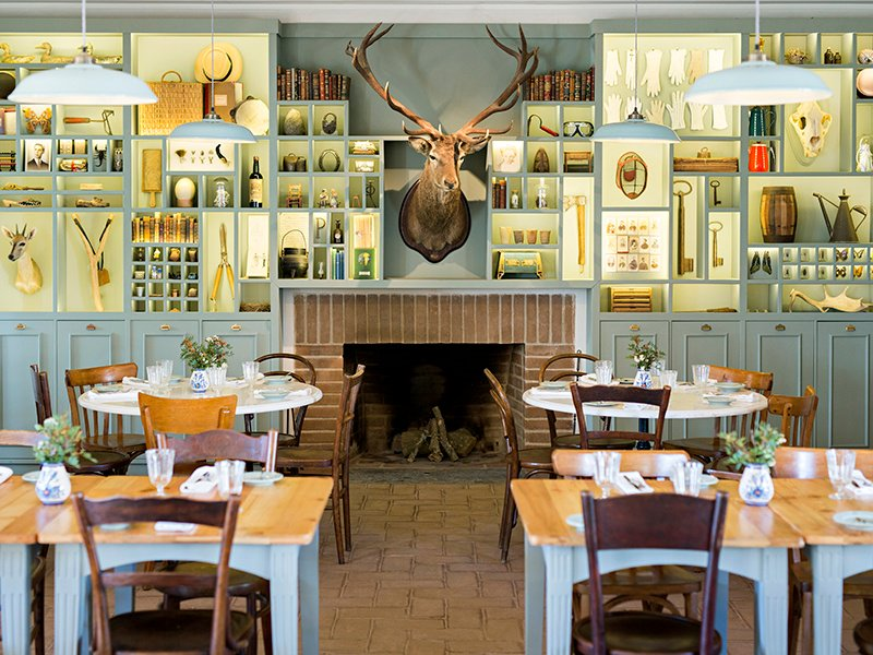 The rustic dining room at São Lourenço do Barrocal pays tribute to the building's farming heritage, while the whitewashed bedrooms make the most of the original vaulted ceilings for a sense of light and space.