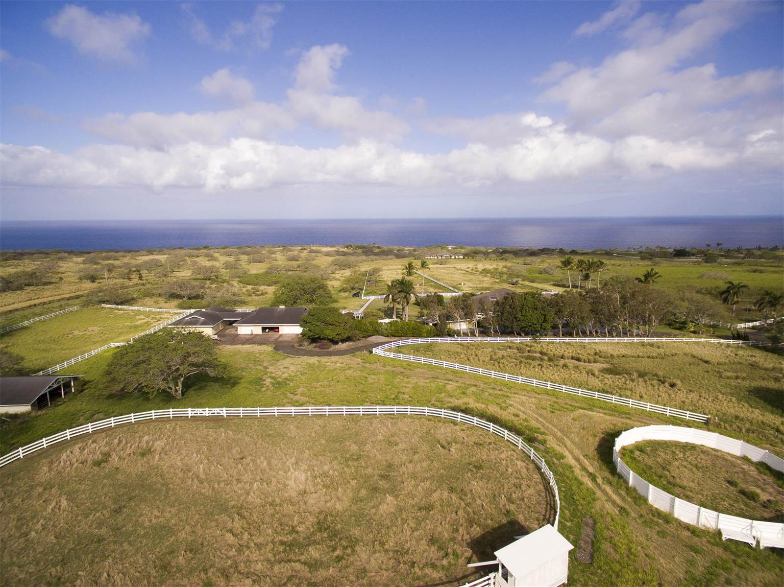 One of the few true equestrian estates on the Big Island, this elegant Puakea Bay Ranch home combines the best of resort and rural lifestyles.