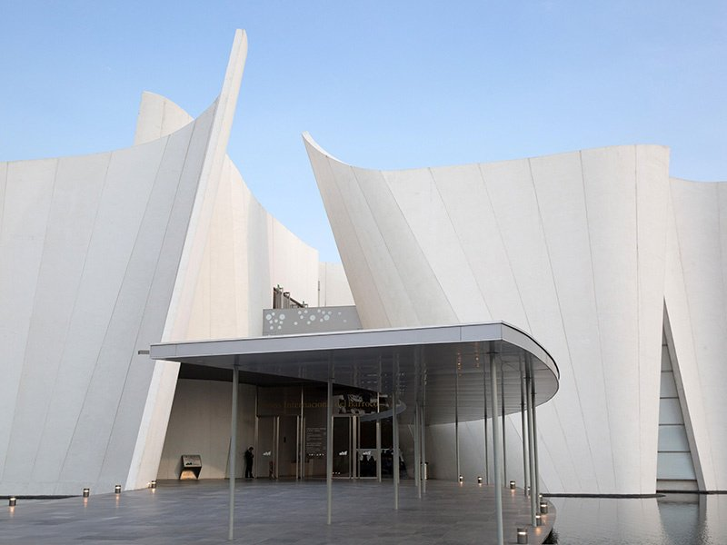 Inspired by principles of the Baroque movement in his design, Toyo Ito used curved concrete walls to create fluidity between galleries, added skylights to provide natural light, and gave great consideration to the environment—the rainwater and sewage are treated and then used to feed the pond that surrounds the Museo Internacional del Barroco outside Puebla, Mexico. Photograph: Alamy