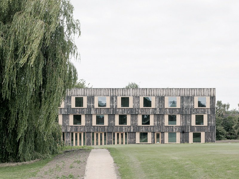 Built in the brutalist style, and clad in blackened-oak paneling, Cowan Court is a 68-room residence for students of Cambridge University's Churchill College. Photograph: Johan Dehlin