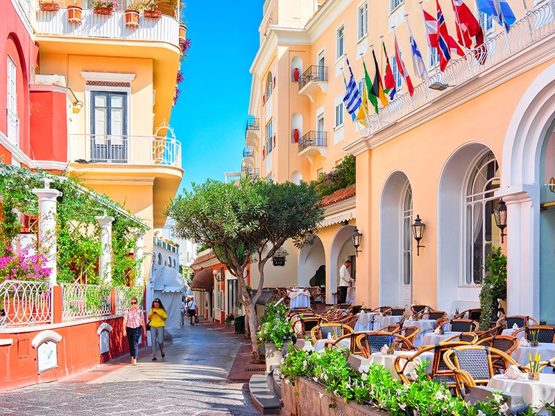 Capri's colorful streets are filled with restaurants and designer fashion boutiques such as Dolce & Gabbana and La Parisienne, reputedly the best place for a pair of made-to-measure Capri pants. Photograph: Getty Images