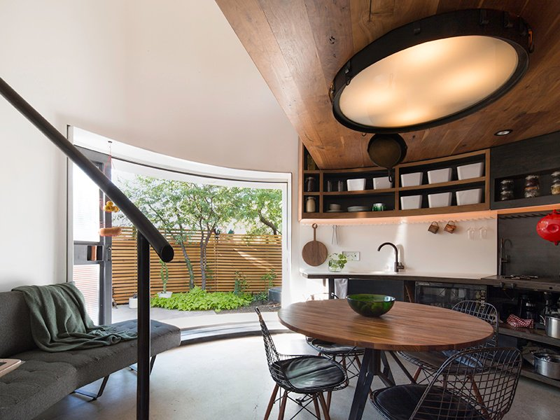 To create a feeling of space in Phoenix's Silo House, architects created an indoor-outdoor connection and pushed storage, surfaces, and the bathroom to the edges of the structure. Photograph: Matt Winquist