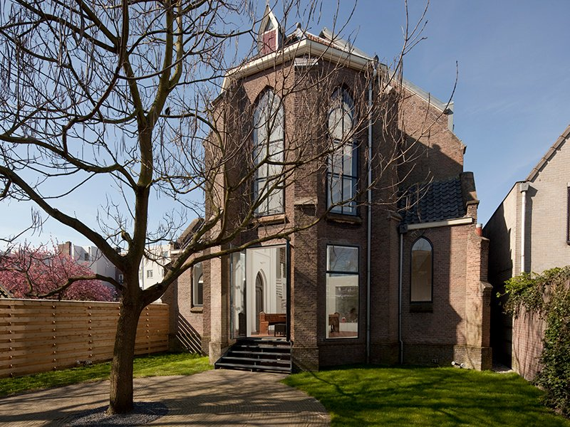 A fusion of old and new, the residence in St Jakobus Church in Utrecht was created without altering the original construction of the church. Photograph: Frank Hanswijk