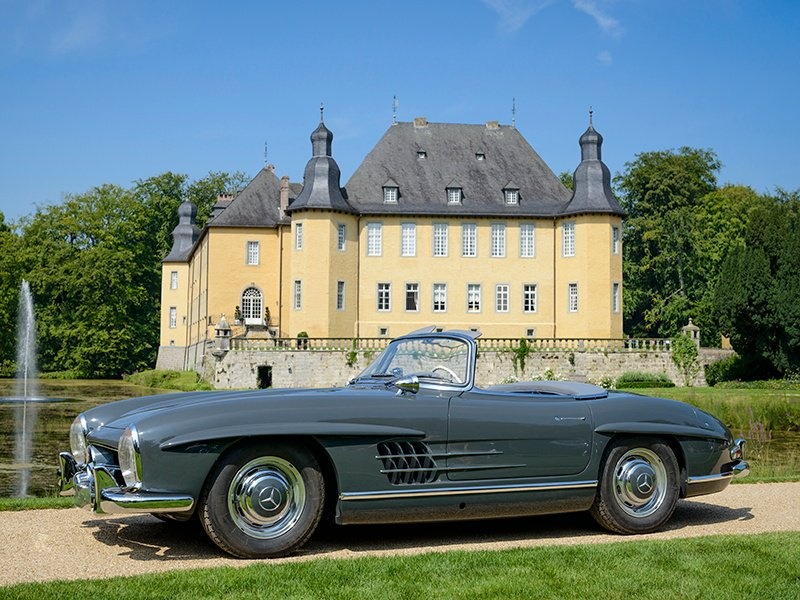 A grey Mercedes-Benz SL Gullwing takes to the road. Driving your pride and joy is one of the great attractions of collecting classic cars. Photo: Getty.