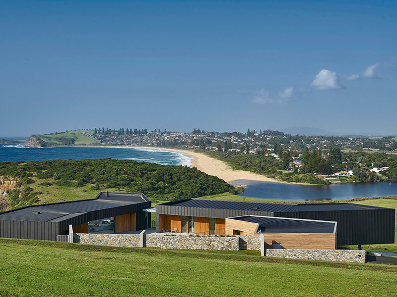 The angular, metal-clad volumes of Headland House in New South Wales, Australia, each have a widow at the end to provide breathtaking framed views of the coastline, and of the dramatic storms that move in from the ocean. Photograph: Michael Nicholson