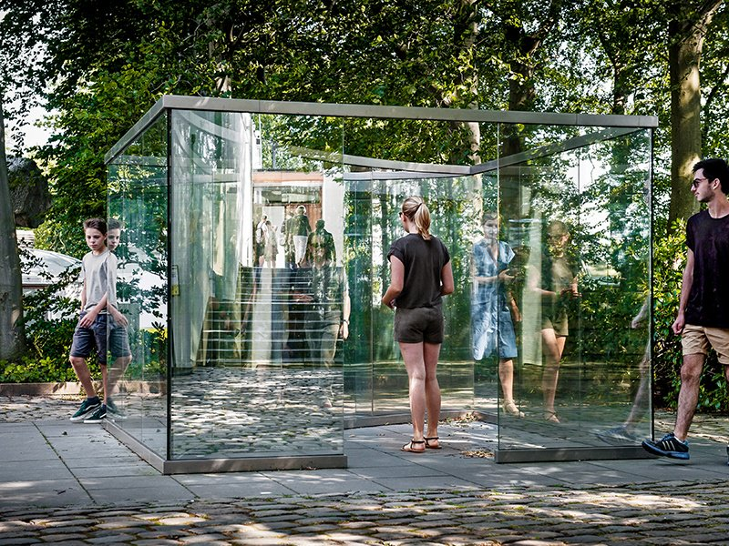 The stainless-steel and two-way-mirror glass piece, Square Bisected by Curve by New York-based artist Dan Graham, is on display at the Louisiana Museum of Modern Art in Denmark. Photograph: Kim Hansen. Credit: Louisiana Museum of Modern Art.