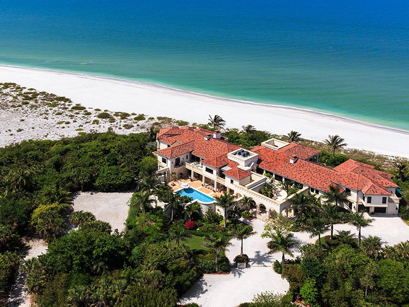 A sprawling Mediterranean-style villa on an unspoiled barrier island, this property exudes Italian design and has plenty of elegant gardens, balconies, and terraces, as well as a spectacular sea view.