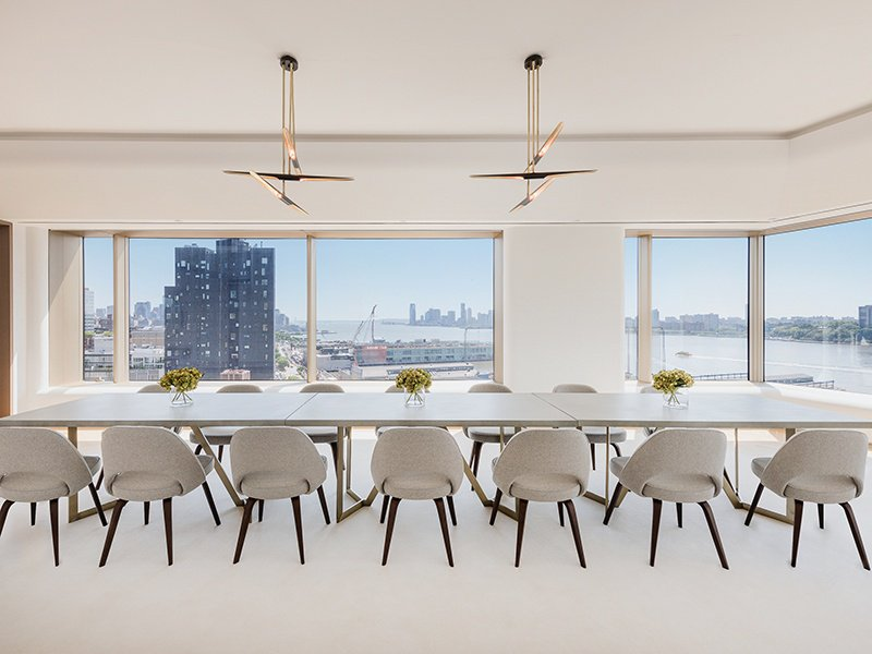 The dramatic Hudson River view from the 15th floor dining room at 551 West 21st Street is a perfect backdrop for entertaining.