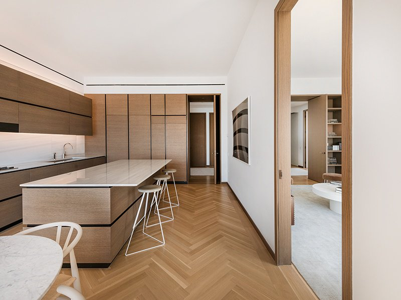 There are two kitchens in the 15th floor apartment, including this eat-in version with Blanco Macael marble countertops.