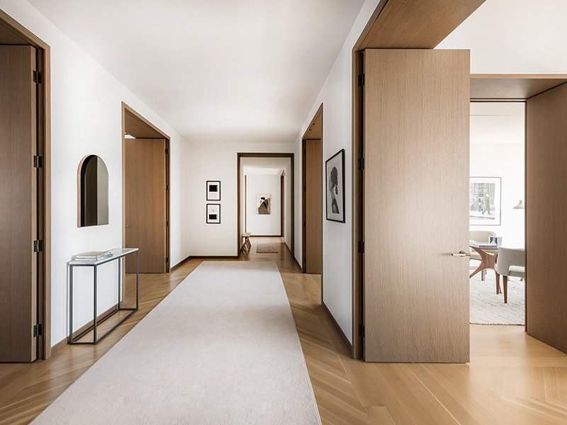The hallway of the 15th floor apartment at 551 West 21st Street—the 19-story waterfront building was designed by renowned architects Foster + Partners.
