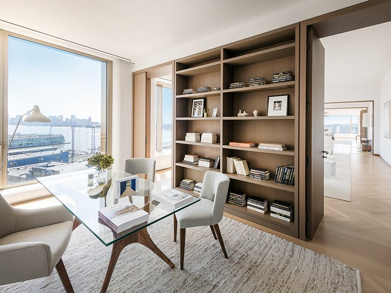With gracious proportions, the 15th floor features French-inspired oak herringbone floors, naturally stained oak cabinetry, and custom millwork throughout.