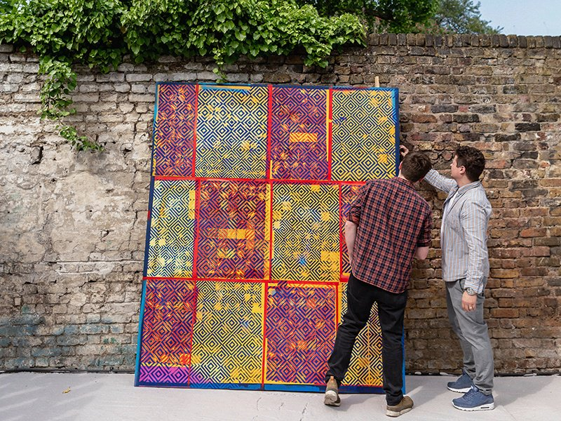 Dominic Beattie's large-scale work Four String is seen by FOLD gallery director Kim Savage before being transported to the exhibition space. Photograph: Chris Terry.