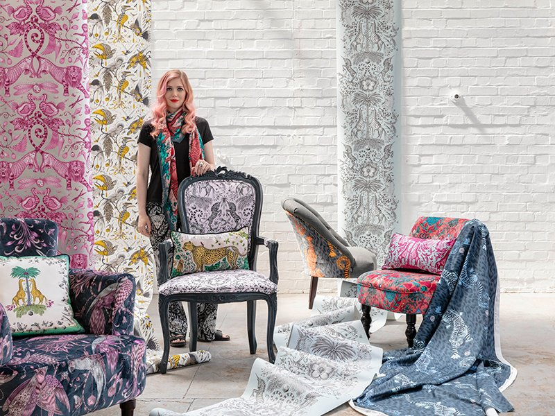 Emma J Shipley's designs include a range of chairs made with interiors experts Clarke & Clarke. She wears the Zambezi silk chiffon scarf in pink with Amazon silk trousers. Photograph: Ben Anders.
