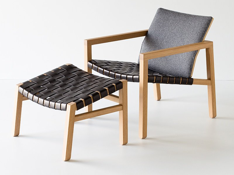 Furniture designer Christopher Solar's creations include the Alpha Lounge and Ottoman. The seat is comprised of leather straps around a hardwood frame, while the back is upholstered in wool.