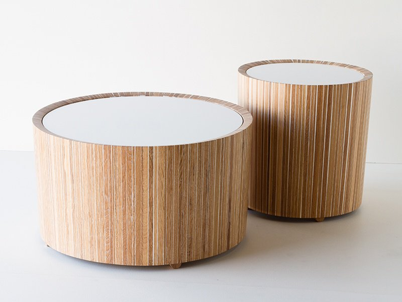 Slats of white oak are molded together with white resin for Christopher Solar's Drum Tables.
