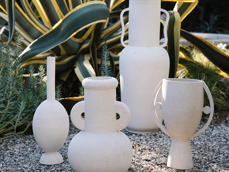 White vases in front of plants